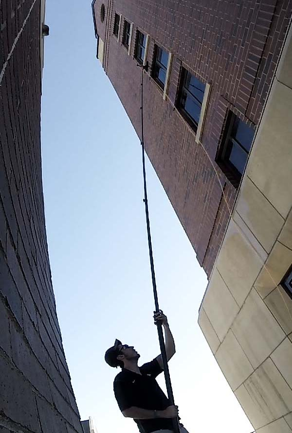 Cleaning a tall building with a Water-Fed System